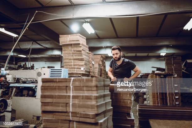Bearded Cardboard Worker Is Tired Of Night Shifts