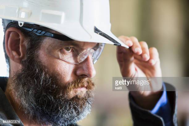 Bearded construction worker wearing hardhat