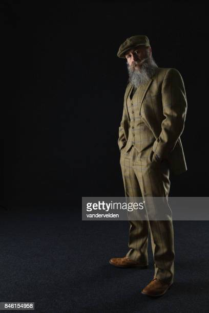 Bearded gentleman in his 50s wearing a 3-piece suit