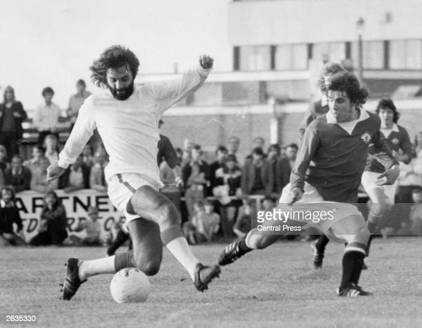 A bearded George Best in action for the Southern League club Dunstable Town during a match against Manchester United reserve players in Bedforshire