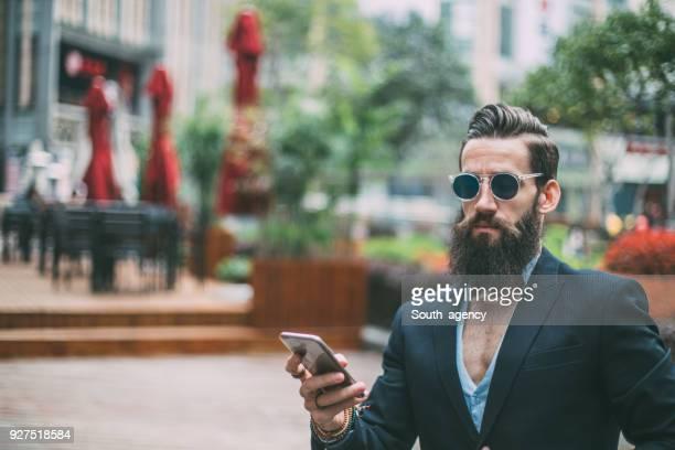 Bearded guy texting