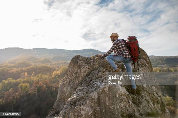 bearded hiker going up - one young man only stock pictures, royalty-free photos & images