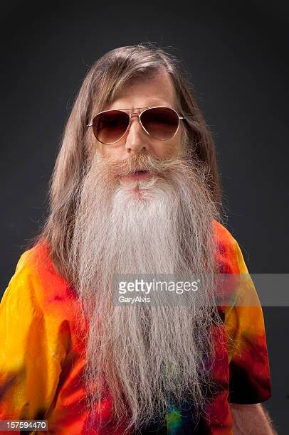 bearded hippie man w/sunglasses and tie-dye shirt/isolated - long hair stock pictures, royalty-free photos & images