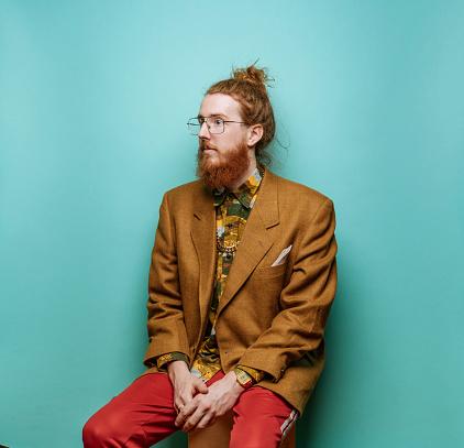 Bearded Hipster man wearing jacket on blue background - gettyimageskorea