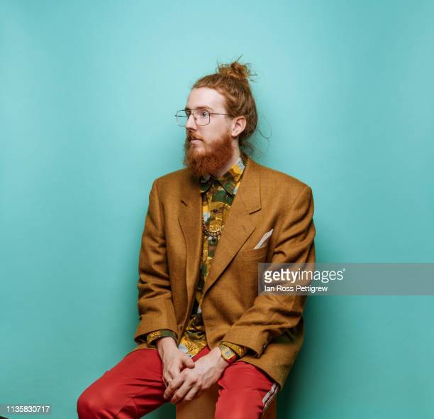 bearded hipster man wearing jacket on blue background - blazer jacket stock pictures, royalty-free photos & images