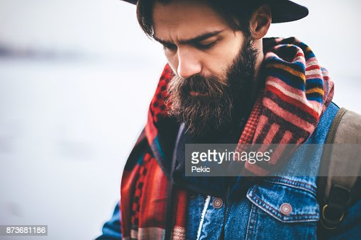 Bearded hipster man with hat
