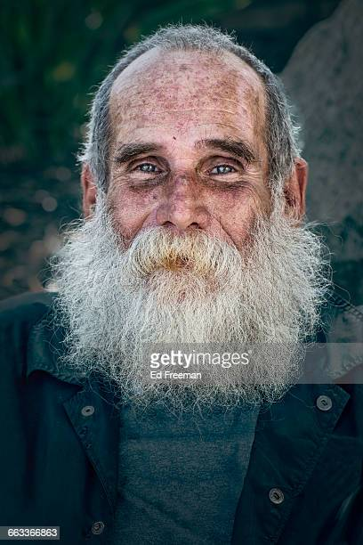 bearded homeless man - homeless foto e immagini stock