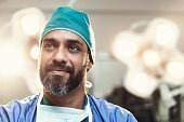 Bearded male surgeon working in operating room