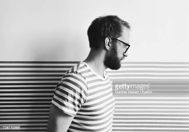 Bearded Man Against Patterned Wall