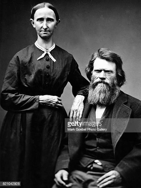 Bearded man and stern wife 1880s
