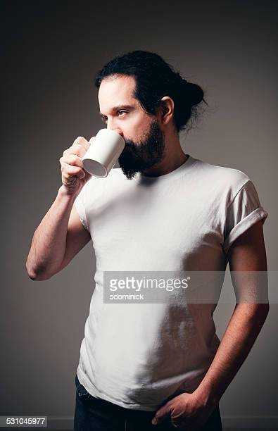 Bearded Man Enjoying Cup Of Coffee