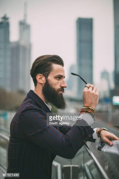 Bearded man in big city