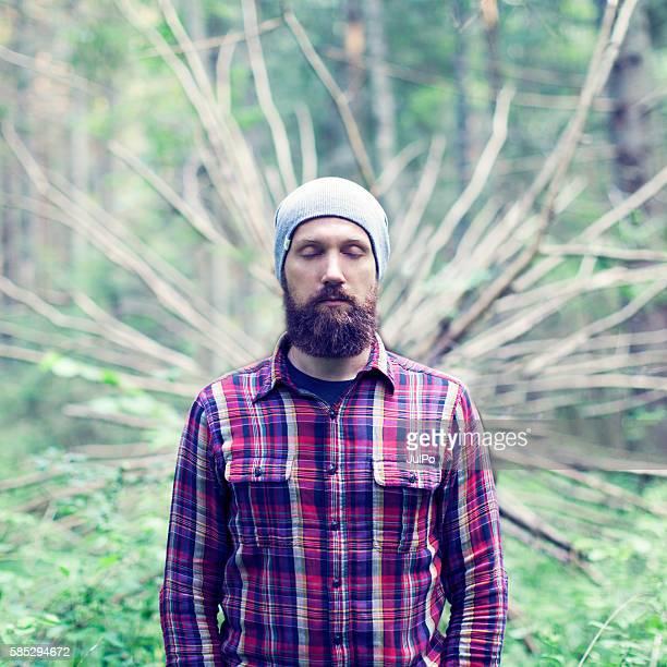 Bearded man in forest