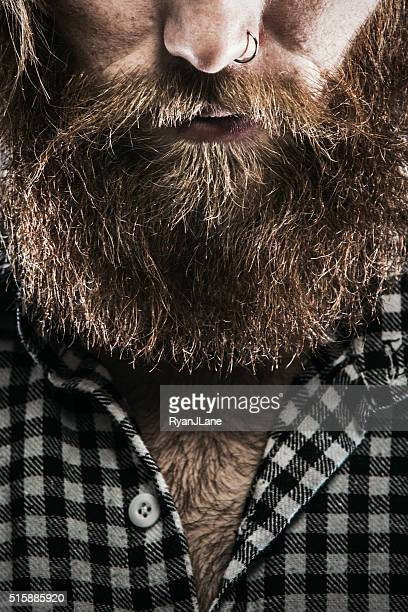 Bearded Man in Plaid With Piercing