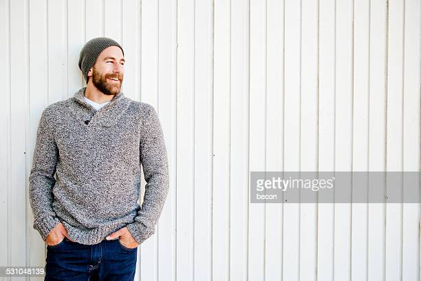 bearded man laughing - sweater stock pictures, royalty-free photos & images