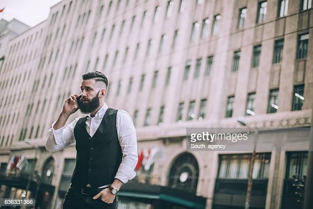 Bearded man on mobile