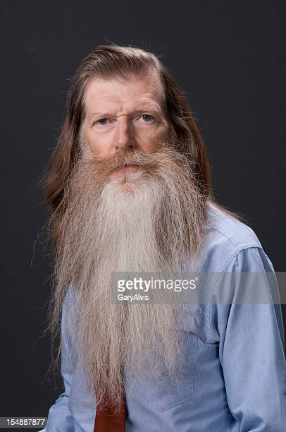 bearded man - long hair stock pictures, royalty-free photos & images