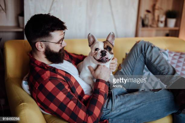 Bearded man playing with his dog