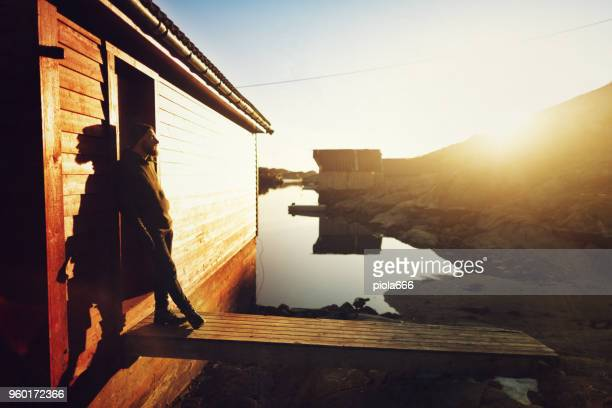 bearded man portrait: by a fjord - traditionally norwegian stock pictures, royalty-free photos & images