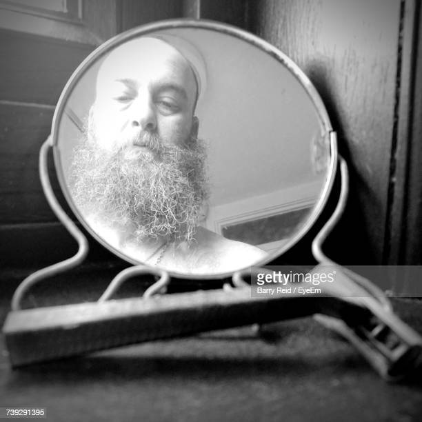 Bearded Man Reflecting On Mirror
