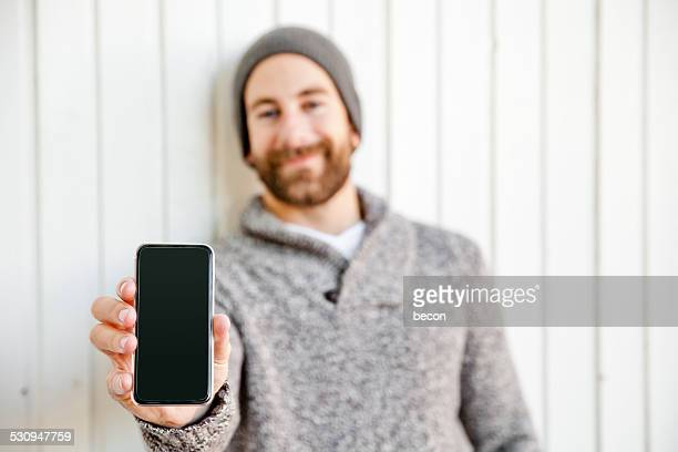 Bearded Man Showing Mobile Phone