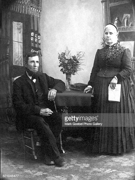 Bearded man sitting and woman standing 1890s