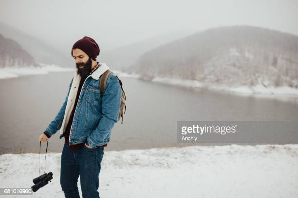 bearded man sneezes outdoors on a cold winter day - tree man syndrome stock photos and pictures