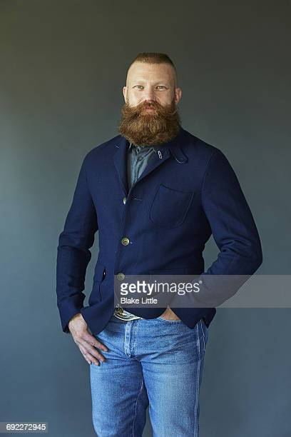 Bearded Man Vintage Jacket studio smiling