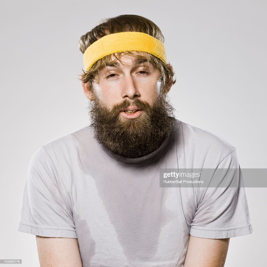 bearded man wearing a headband : Foto de stock