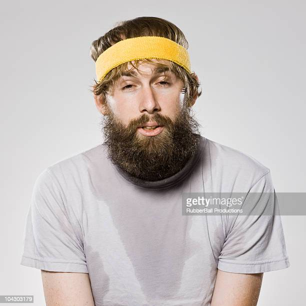 bearded man wearing a headband - headband stock pictures, royalty-free photos & images