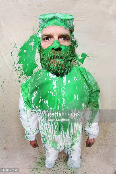 bearded man wearing painter overalls - scott macbride stock pictures, royalty-free photos & images