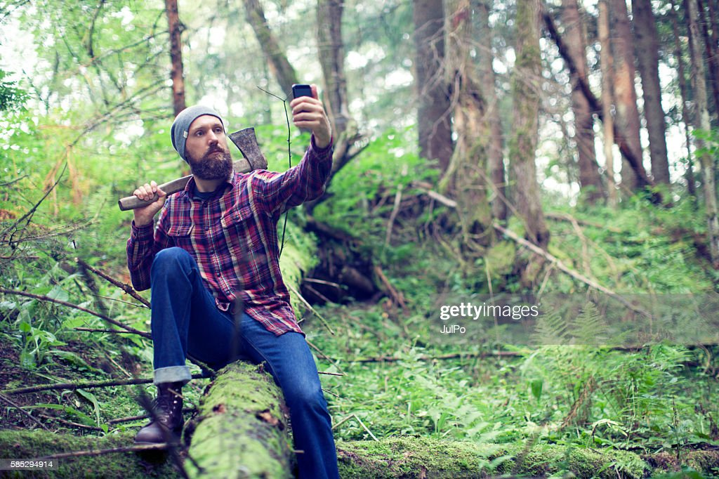 Bearded man with axe : Stock Photo