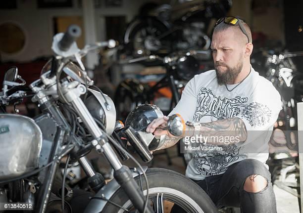 bearded man with custom motorcycle