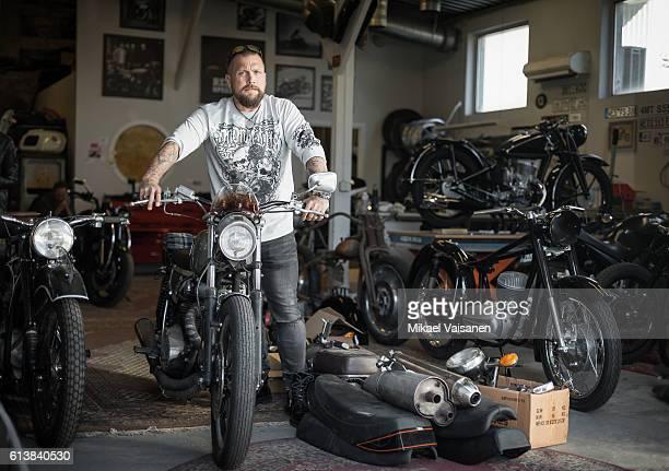 bearded man with custom motorcycles