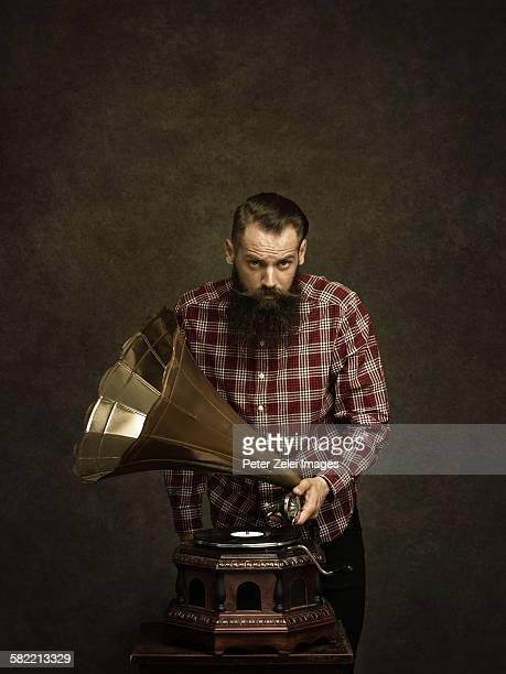 Bearded man with gramophone