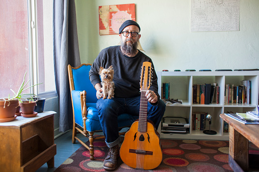 Bearded man with small dog and mandolin - gettyimageskorea