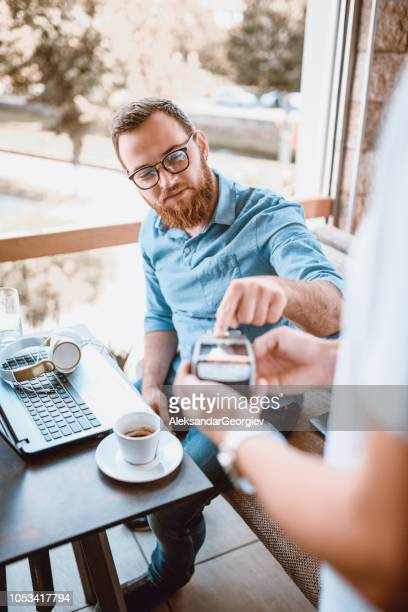 Bearded Men Paying Bill Via Mobile Phone