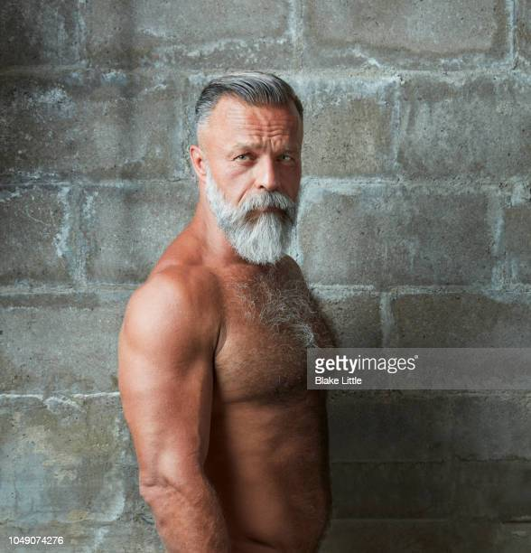 Bearded Middle-aged Man on Concrete Wall