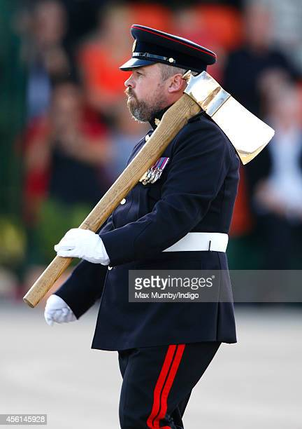 A bearded Pioneer Sergeant carries a Pioneer Axe during the 23 Pioneer Regiment RLC Disbandment Parade at St David's Barracks on September 26 2014 in...