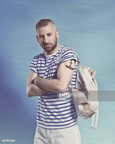 Bearded sailor man wearing striped t-shirt