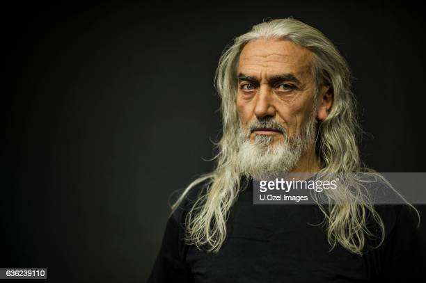 bearded senior man portrait, age:55 - long hair stock pictures, royalty-free photos & images