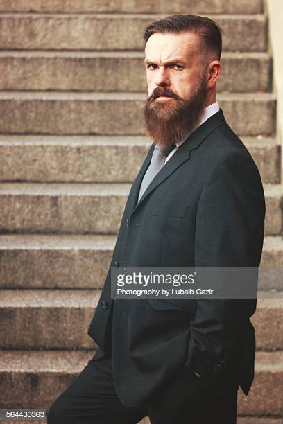 Bearded serious businessman