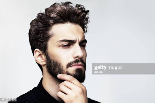 bearded stylish man posing outdoors - model stock photos and pictures