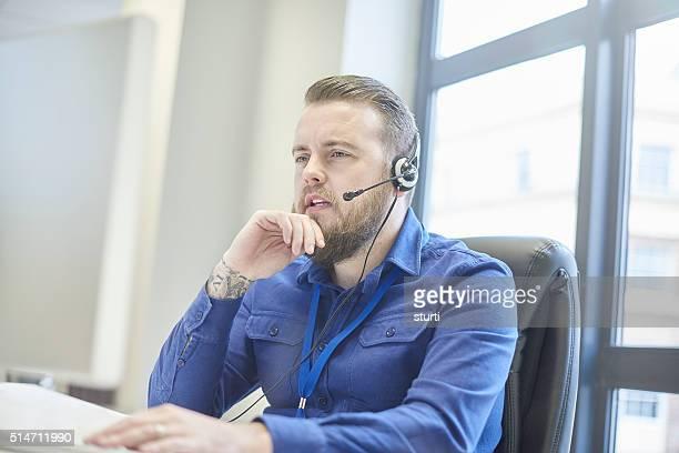 bearded tattooed customer service rep