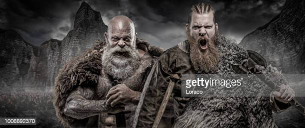 bearded tattooed viking warrior king and prince in front of warrior hoard and background - movie poster stock photos and pictures
