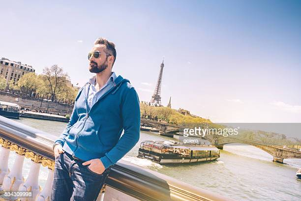 bearded tourist with sun glasses on Pont Alexandre in paris