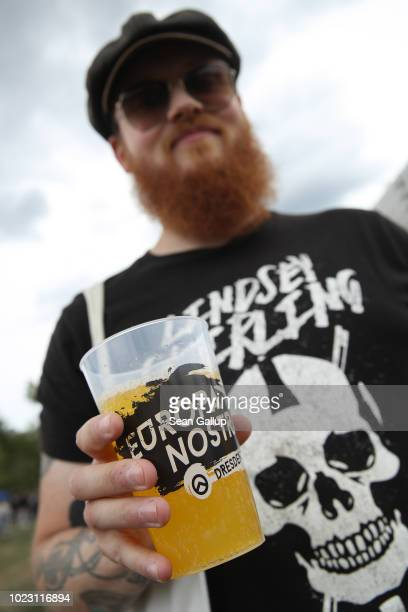A bearded visitor holds a beer while attending a gathering entitled Europa Nostra and hosted by the Identitarian Movement on August 25 2018 in...