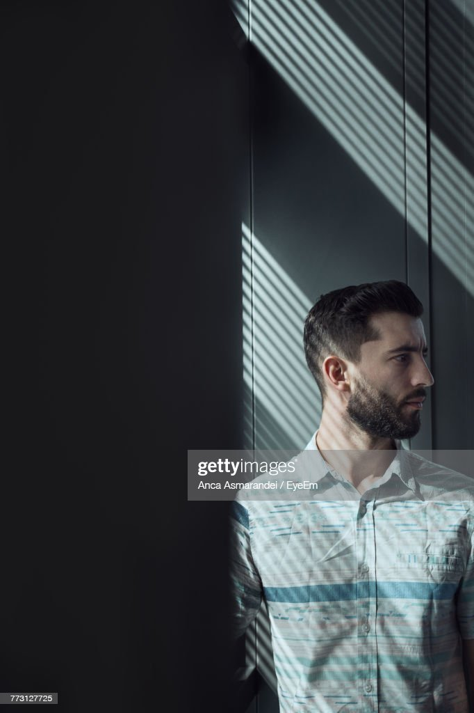 Bearded Young Man Against Wall : Photo