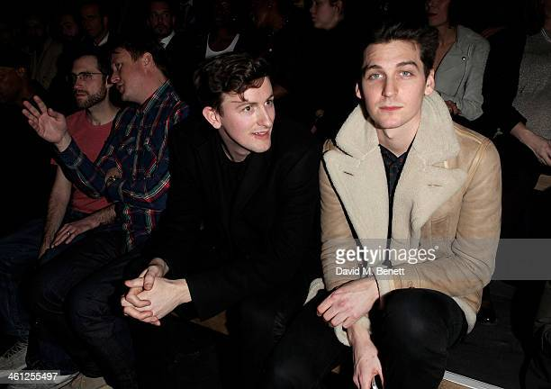 Beardyman Adam Dewhurst Teddy Edwards and George Craig sit in the front row during the Superdry AW14 catwalk event as part of London Collections Men...