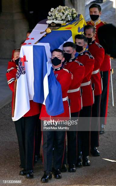 Bearer Party of Grenadier Guards carry Prince Philip, Duke of Edinburgh's coffin out of the State Entrance of Windsor Castle ahead of his funeral...